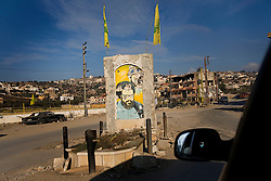A damaged depiction of Hezbollah leader Sayyid Hassan Nasrallah remains in the center of Bint Jbeil, Southern Lebanon, Oct. 23, 2006.  <br />