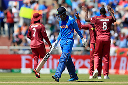 India's KL Rahul walks off dejected after being dismissed by West Indies' Jason Holder (right) during the ICC Cricket World Cup group stage match at Emirates Old Trafford, Manchester.