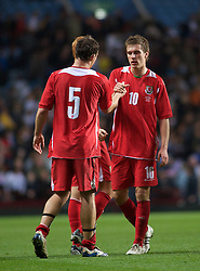 BIRMINGHAM, ENGLAND - Monday, October 13, 2008: Wales' Aaron Ramsey and Darcy Blake look dejected after losing to England during the UEFA European Under-21 Championship Play-Off 2nd Leg match at Villa Park. (Photo by Gareth Davies/Propaganda)
