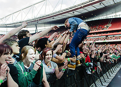 "© Licensed to London News Pictures. 01/06/2013. London, UK.   Ricky Wilson of the Kaiser Chiefs stands amongst the audience as the band perform live at The Emirates Stadium, supporting headliner Green Day.   Kaiser Chiefs are a British indie rock band from Leeds who formed in 1996. The band consists of lead vocalist Ricky Wilson, guitarist Andrew ""Whitey"" White, bassist Simon Rix, keyboardist Nick ""Peanut"" Baines and live drummer Vijay Mistry. Photo credit : Richard Isaac/LNP"