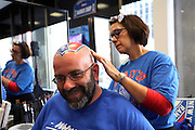 May 13, 2015 - New York, NY. Rich Tarrant gets his headed painted with Rangers flare prior to entering game 7 against the Washington Capitals, at Madison Square Garden. Photograph by Anthony Kane/NYCity Photo Wire