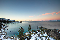 """Sand Harbor Sunrise 1"" - Photograph of Sand Harbor in the distance shot at sunrise, the moon can be seen in the photo."