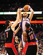 Jan. 24, 2012; Phoenix, AZ, USA; Phoenix Suns center Marcin Gortat (4) puts up the ball against the Toronto Raptors forward Andrea Bargnani (7) and guard DeMar DeRozan (10) during the second half at the US Airways Center. The Raptors defeated the Suns 99-96. Mandatory Credit: Jennifer Stewart-US PRESSWIRE...