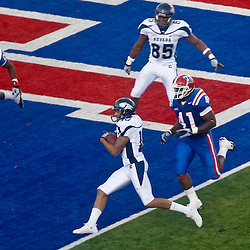 December 4, 2010; Ruston, LA, USA;  Nevada Wolf Pack quarterback Colin Kaepernick (10) scores a touchdown during the third quarter against the Louisiana Tech Bulldogs at Joe Aillet Stadium.  Mandatory Credit: Derick E. Hingle