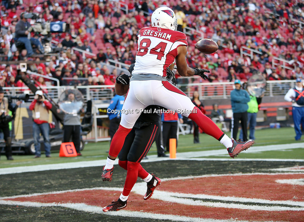 Arizona Cardinals tight end Jermaine Gresham (84) jumps while trying to catch an incomplete third quarter end zone pass while covered by San Francisco 49ers inside linebacker Michael Wilhoite (57) who gets called for pass interference giving the Cardinals a first and goal at the one yard line during the 2015 week 12 regular season NFL football game against the San Francisco 49ers on Sunday, Nov. 29, 2015 in Santa Clara, Calif. The Cardinals won the game 19-13. (©Paul Anthony Spinelli)