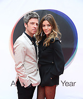 Noel Gallagher and Sara MacDonald at arrival boards