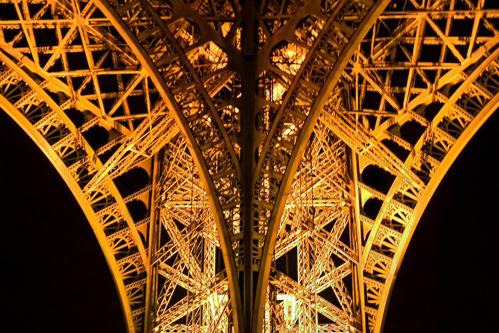 The Eiffel Tower is a 19th century iron lattice tower located on the Champ de Mars in Paris that has become both a global icon of France and one of the most recognizable structures in the world. The Eiffel Tower, which is the tallest building in Paris, is the single most visited paid monument in the world; millions of people ascend it every year. Named after its designer, engineer Gustave Eiffel, the tower was built as the entrance arch for the 1889 World's Fair. The tower stands at 324m (1,063 ft) tall, about the same height as an 81-story building and has three levels for visitors.