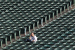 OAKLAND, CA - OCTOBER 21: A fan sits amongst empty seats while talking on a cell phone before the game between the Oakland Raiders and the Jacksonville Jaguars at O.co Coliseum on October 21, 2012 in Oakland, California. The Oakland Raiders defeated the Jacksonville Jaguars 26-23 in overtime. Photo by Jason O. Watson/Getty Images) *** Local Caption ***