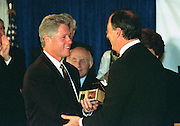 US President Bill Clinton is gifted a Tzedakah box or charity box made in 1435 in Eastern Europe by Jeffery Hirschberg before addressing the National Jewish Democratic Council November 2, 1995 in Washington, DC.