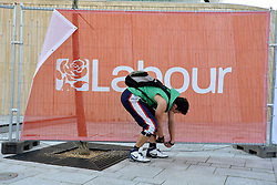 © Licensed to London News Pictures. 29/09/2011. LONDON, UK. A man removes Labour Party hoardings after the close of the The Labour Party Conference in Liverpool today (29/09/11). Photo credit:  Stephen Simpson/LNP