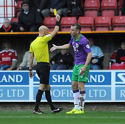 Bristol City's Aaron Wilbraham receives a yellow card. - Photo mandatory by-line: Dougie Allward/JMP - Mobile: 07966 386802 - 15/11/14 - SPORT - Football - Swindon - The County Ground - Swindon Town v Bristol City - Sky Bet League One