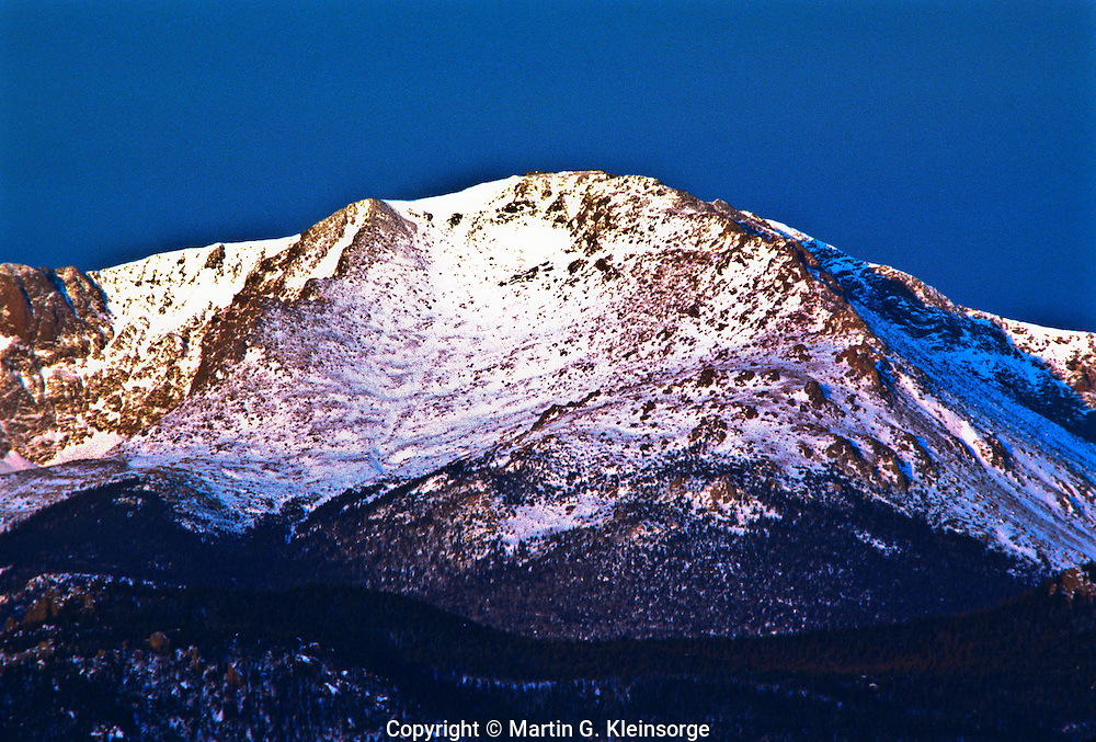 Sunrise on the snow covered 14,110 ft. Pikes Peak (America's Mountain) . Colorado.