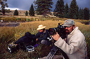Videographers taping beaver at pond, Grand Teton National Park, near Moose, Wyoming..Subject photograph(s) are copyright Edward McCain. All rights are reserved except those specifically granted by Edward McCain in writing prior to publication...McCain Photography.211 S 4th Avenue.Tucson, AZ 85701-2103.(520) 623-1998.mobile: (520) 990-0999.fax: (520) 623-1190.http://www.mccainphoto.com.edward@mccainphoto.com