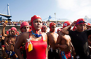 A lifeguard from El Salvador's Red Cross gestures as he enters the ocean to take part in the 'Men's Step' event in La Libertad, El Salvador, Sunday, Feb. 27, 2011. Lifeguards in El Salvador are required to swim 21 kilometers in the ocean to graduate (Photo: Edgar Romero/Imagenes Libres)