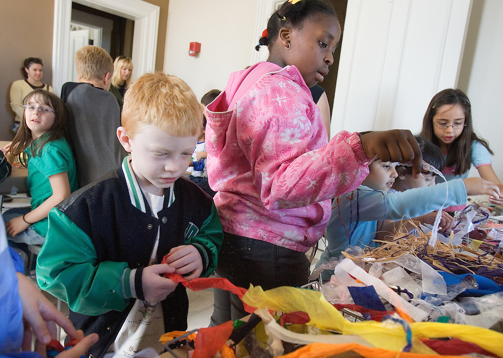 Oliva Kimball (from left) watches as  Connor Pepper, Zenzi Mda, Suzy Abdelquader and Daniela Grijalva grab supplies during an outing with East Elementary School students to the new educational space at the Kennedy Art Museum on Friday, 10/6/06.