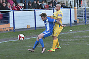 Scarborough Athletic, Craig Nelthorpe (7) and Glossop North End  Iwan Heeley (7) during the Evo-Stik Premier League match between Glossop North End and Scarborough Athletic at the Arthur Goldthorpe Stadium, Glossop, United Kingdom on 26 November 2016. Photo by Mark Pollitt.