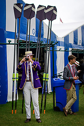 © Licensed to London News Pictures. 28/06/2017. London, UK. A spectatora in rowing club colours takes a picture on day one of the Henley Royal Regatta, set on the River Thames by the town of Henley-on-Thames in England.  Established in 1839, the five day international rowing event, raced over a course of 2,112 meters (1 mile 550 yards), is considered an important part of the English social season. Photo credit: Ben Cawthra/LNP