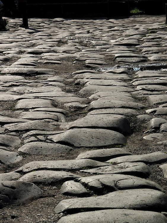 Ancient paving stones of the main street (Via Sacra)  in the Roman Forum.  Close up, low angle of view.