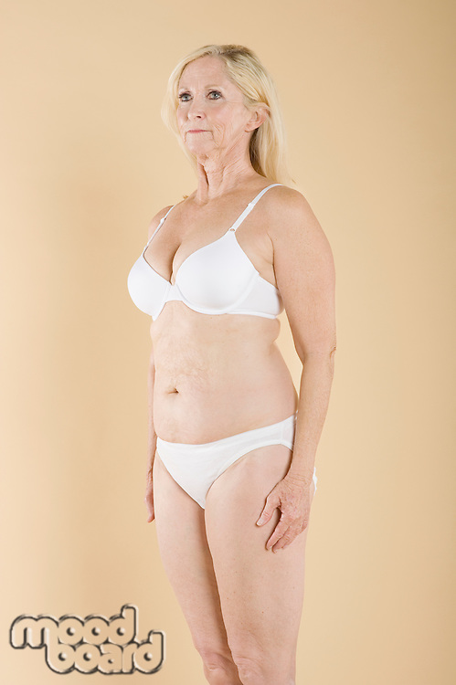 Middle aged woman in white lingerie