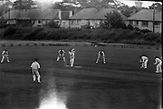 Ireland v. Leicester, Cricket at Sydney Parade..1963..07.07.1963..7th July 1963.  .Today Ireland played Leicester at cricket in the Pembroke Cricket Club grounds at Sydney Parade, Ballsbridge ,Dublin...Ireland's opening bat, Stanley Bergin, is pictured forcing the ball away despite the attention of the Leicester fielders.