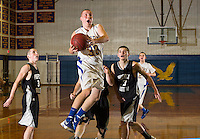 Gilford's MacKenzie Meyers goes airborne for a shot during the championship matchup with Prospect Mountain for the conclusion of the Holiday Basketball Tournament Monday night at GHS.  (Karen Bobotas/for the Laconia Daily Sun)