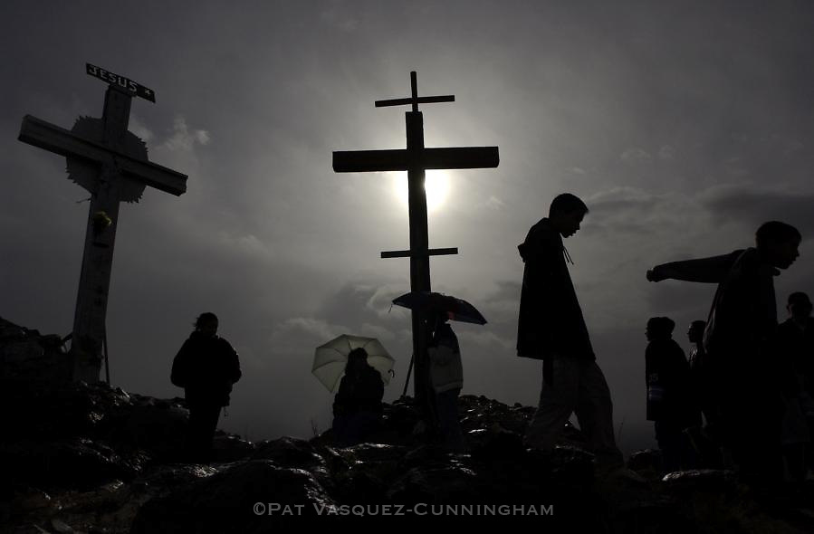 pvcTOME1/3-25-05/JP4/WEST.  Pilgrims braved the elements to journey to the top of El Cerro in Tome on Good Friday to commemorate the crucifixion of Jesus, photographed Friday March 25, 2005.   (Pat Vasquez-Cunningham/Journal)