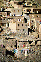 Buildings with hanging laundry on terraced slope