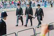 Security was tight and in many guises even in top hats - Queens 90th birthday was celebrated by the traditional Trooping the Colour as well as a flotilla on the river Thames.
