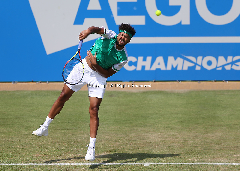 June 21st 2017, Queens Club, West Kensington, London; Aegon Tennis Championships, Day 3; Jo-Wilfried Tsonga of France serves the ball to Gilles Muller of Luxembourg
