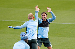 Manchester City's Kevin De Bruyne (left) and Kyle Walker share a joke during the training session at the City Football Academy, Manchester.