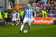 Aaron Mooy of Huddersfield Town (10) in action during the Premier League match between Huddersfield Town and Leicester City at the John Smiths Stadium, Huddersfield, England on 6 April 2019.