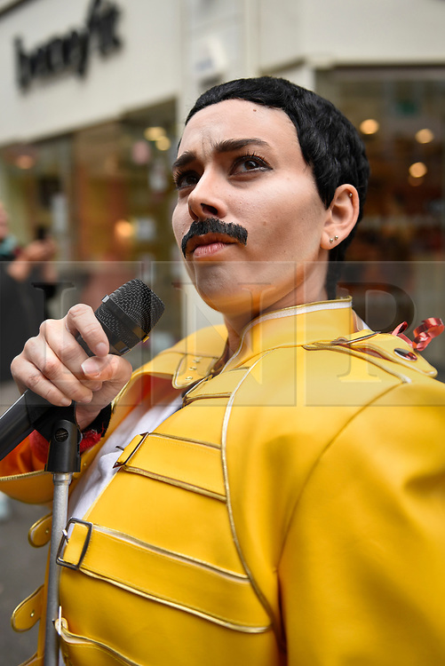 """© Licensed to London News Pictures. 05/09/2018. LONDON, UK.  Charlotte Quinn, a drag king and Queen fan from San Franscisco, strikes a pose in Carnaby Street during """"Freddie for a Day"""", a fundraising event in aid of the Mercury Phoenix Trust on Freddie Mercury's birthday.  Queen tribute band """"Bulsara and the Queenies"""" sang iconic songs entertaining crowds.  Photo credit: Stephen Chung/LNP"""