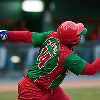15 February 2009: Joan Carlos Pedroso of the Orientales hits a homerun during a training game of Cuba Baseball Team for the World Baseball Classic 2009. The national team is pitted against itself, divided in two teams called the Occidentales and the Orientales. The Orientales win 12-8, at the Latinoamericano stadium, in la Habana, Cuba.