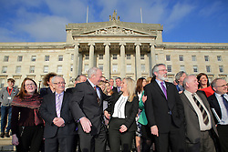 © Licensed to London News Pictures. STORMONT BELFAST - 23 JAN 2017: Sinn Fein's Michelle O'Neill (centre) gets a hug from Martin McGuinness, while stood next to Gerry Adams (third from right), on the steps of Stormont after being named as the new leader of Sinn Fein in the North, taking over from former deputy first minister Martin McGuinness who has retired due to illness. Photo credit: London News Pictures.