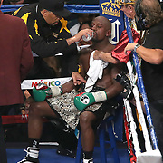 LAS VEGAS, NV - SEPTEMBER 13: Floyd Mayweather Jr. sits in his corner between rounds of his WBC/WBA welterweight title fight against Marcos Maidana at the MGM Grand Garden Arena on September 13, 2014 in Las Vegas, Nevada. (Photo by Alex Menendez/Getty Images) *** Local Caption *** Floyd Mayweather Jr; Marcos Maidana