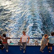 Italian passengers onboard Ferry Toscana to Napoli. Passagers Itlaiens à bord du Ferry Toscana pour Naples.
