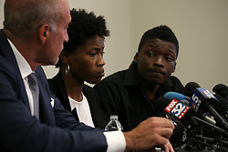 Shooting victim Paul O'Neal's sister Briana Adams, 22, briefs the media at Michael Oppenheimer's, left, law office on August 5, 2016 in Chicago. The family viewed the Chicago police videos from the shooting death of Paul O'Neal early in the day at the IPRA offices with activist Ja'Mal Green, right. Photo by Anthony Souffle/Chicago Tribune/TNS/ABACAPRESS.COM
