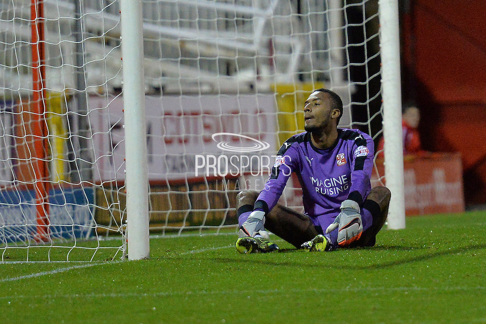 Swindon Town goalkeeper Lawrence Vigouroux after conceding a goal during the Sky Bet League 1 match between Swindon Town and Scunthorpe United at the County Ground, Swindon, England on 14 November 2015. Photo by Mark Davies.
