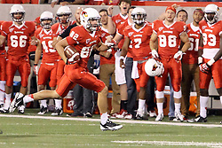 21 September 2013:  Anthony Warrum returns a punt for a touchdown as the horn blows signaling the end of the first half during an NCAA football game between the Abilene Christian Wildcats and the Illinois State Redbirds at Hancock Stadium in Normal IL