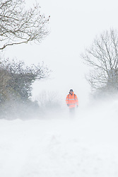 © Licensed to London News Pictures 02/03/2108, Cirencester, UK. A man walking 5 miles home from work along the Gloucester road near Cirencester though deep snow and strong winds. Photo Credit : Stephen Shepherd/LNP