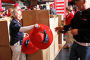 ANAHEIM, CA - MAY 08:  Stadium workers hand out sun hats before the game between the Cleveland Indians and the Los Angeles Angels of Anaheim on Sunday, May 8, 2011 at Angel Stadium in Anaheim, California. The Angels won the game 6-5. (Photo by Paul Spinelli/MLB Photos via Getty Images)