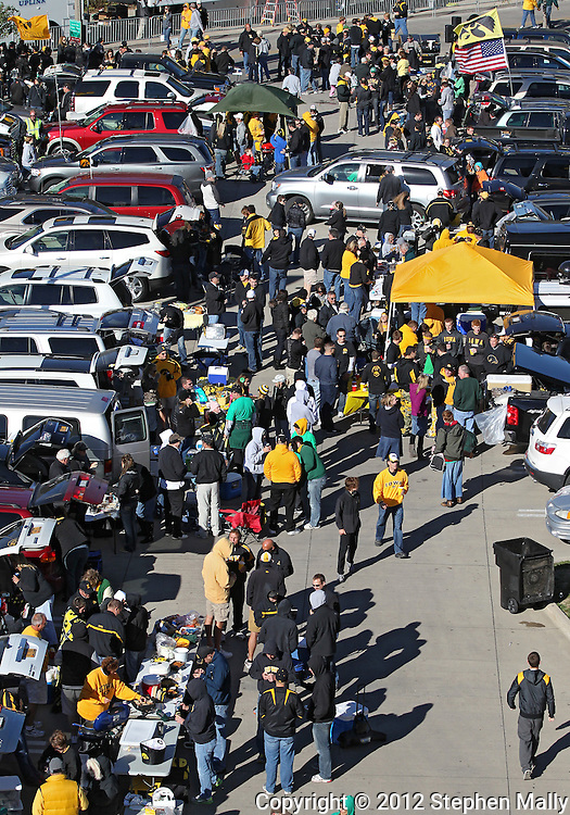 September 22 2012: Fans tailgate outside Kinnick Stadium before the start of the NCAA football game between the Central Michigan Chippewas and the Iowa Hawkeyes at Kinnick Stadium in Iowa City, Iowa on Saturday September 22, 2012. Central Michigan defeated Iowa 32-31.