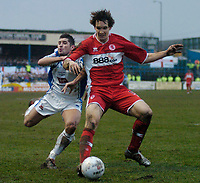 Photo: Leigh Quinnell.<br /> Nuneaton Borough v Middlesbrough. The FA Cup.<br /> 07/01/2006. Nuneatons Gez Murphy is pushed away by Middlesbroughs Emanuel Pogatetz.
