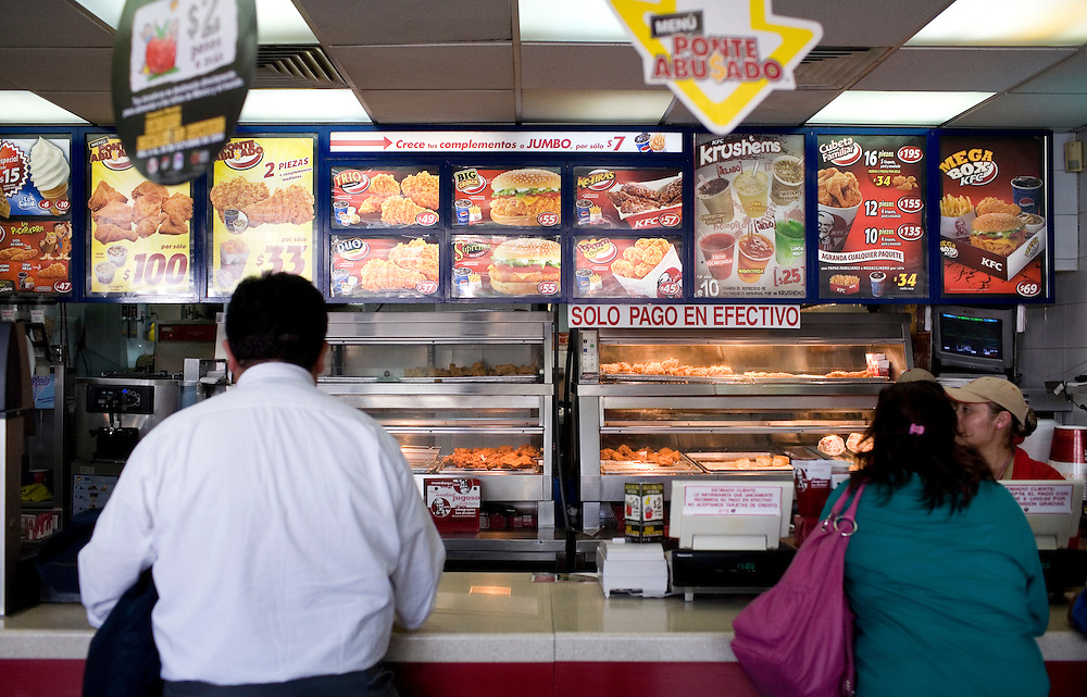 People order food at a Kentucky Fried Chicken in Mexico City.