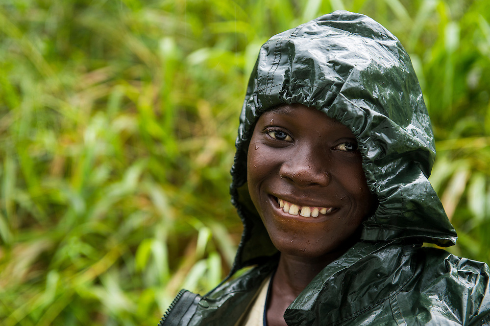 Pretty girl wearing a raincape smiling, Sao Tome, Sao Tome and Principe, Atlantic ocean