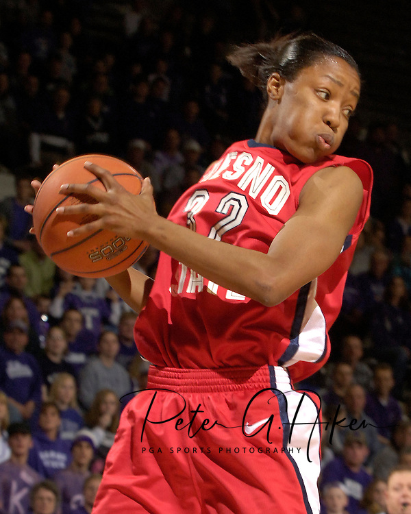 Fresno State guard Jasmine Plummer (32) pulls down a defensive rebound during the second half against Kansas State at Bramlage Coliseum in Manhattan, Kansas, March 22, 2006.  K-State defeated the Bulldogs 64-61 in the second round of the WNIT.