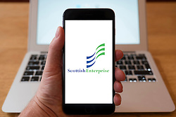 Using iPhone smartphone to display logo of Scottish Enterprise