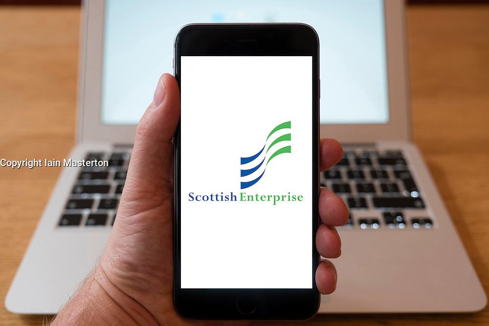 Using iPhone smartphone to display logo of Scottish Enterprise