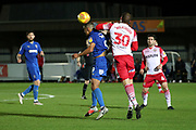AFC Wimbledon striker Kweshi Appiah (9) winning header but getting an elbow in the neck during the EFL Trophy group stage match between AFC Wimbledon and Stevenage at the Cherry Red Records Stadium, Kingston, England on 6 November 2018.