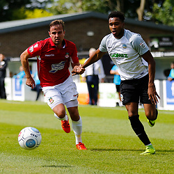 AUGUST 12:  Dover Athletic against Wrexham in Conference Premier at Crabble Stadium in Dover, England. Wrexham's defender Kevin Roberts holds back Dover's forward Kane Richards. (Photo by Matt Bristow/mattbristow.net)